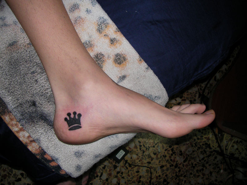 Black Ink Crown Tattoo On Heel