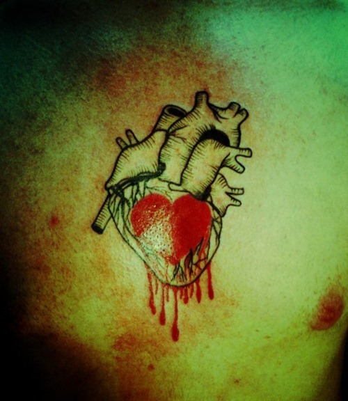Bleeding Heart Tattoo On Chest For Men