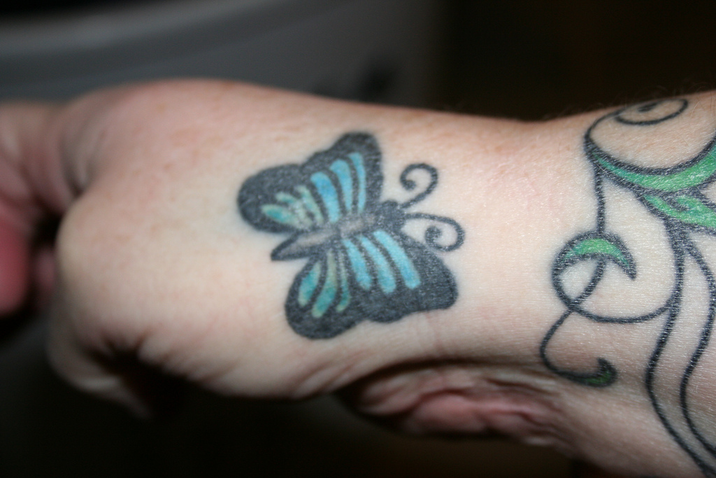 Butterfly Hand Tattoo