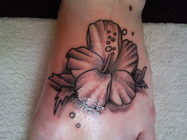Charming Hibiscus Flower Tattoo On Foot