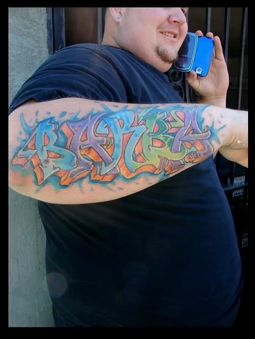 Colorful Graffiti Letters Tattoo Design On Arm