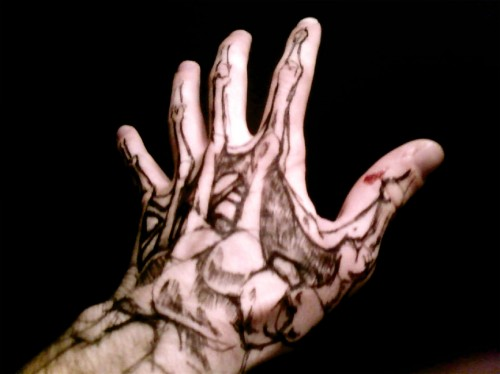Creative Hand Tattoo Design