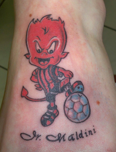 Cute Devil With Football Tattoo Design On Foot