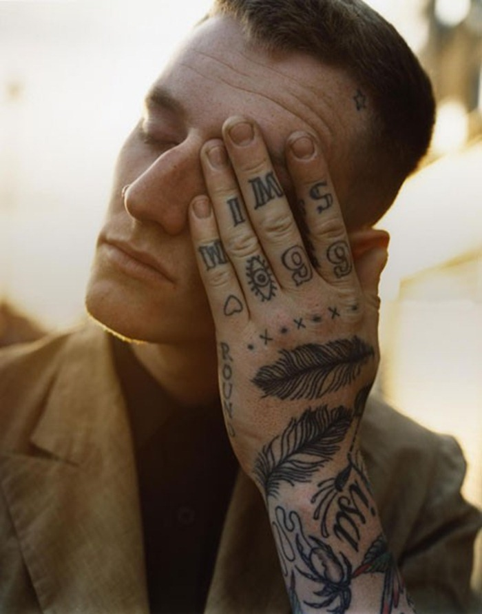 Feathers Tattoo On Hand Of Guy