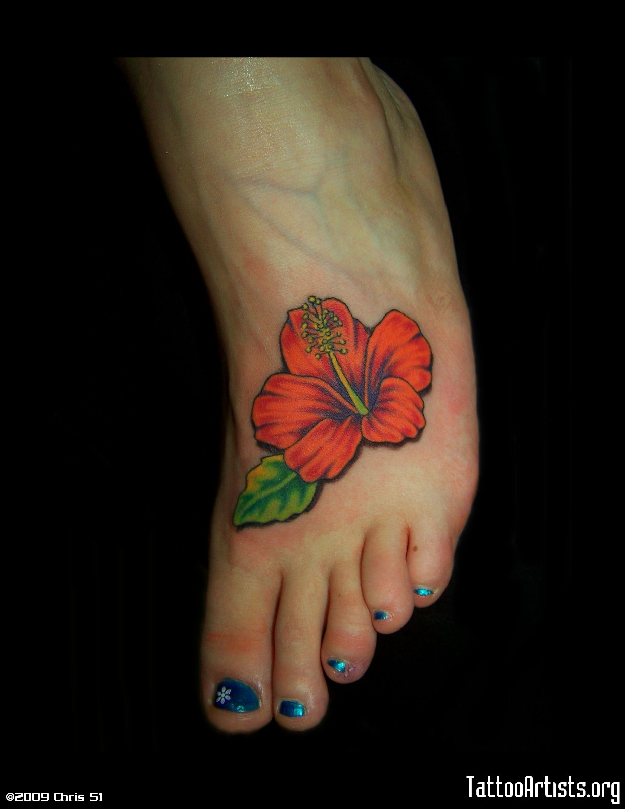 Red Hibiscus Flower Tattoo On Foot