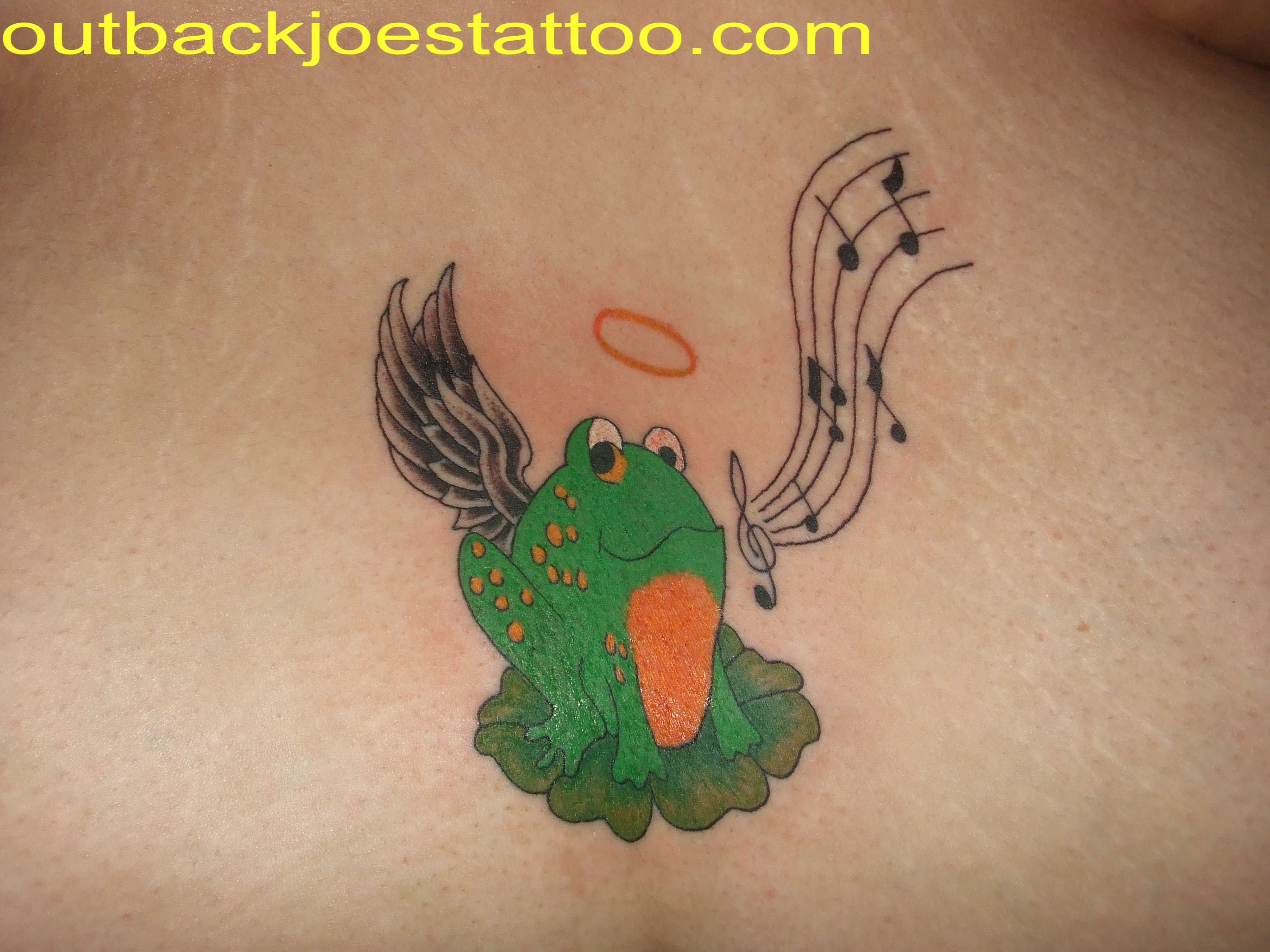 Frog Music Notes Tattoo Design