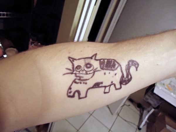 Funky Cat Tattoo On Arm