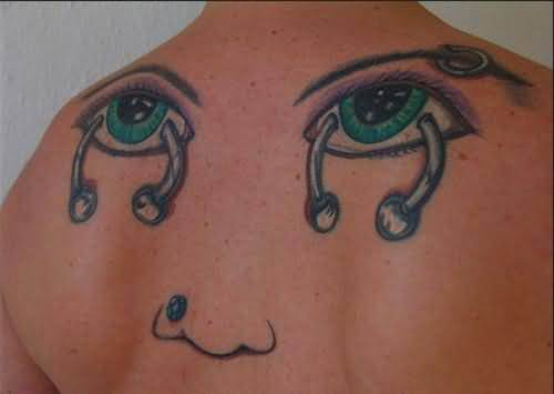 Funny Eyes n Nose Tattoo On Back