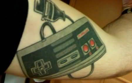 Funny Remote Control Tattoo On Biceps