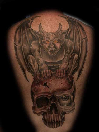 Gargoyle Sitting On Skull Tattoo Design