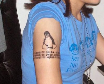 Geek Penguin Tattoo On Biceps