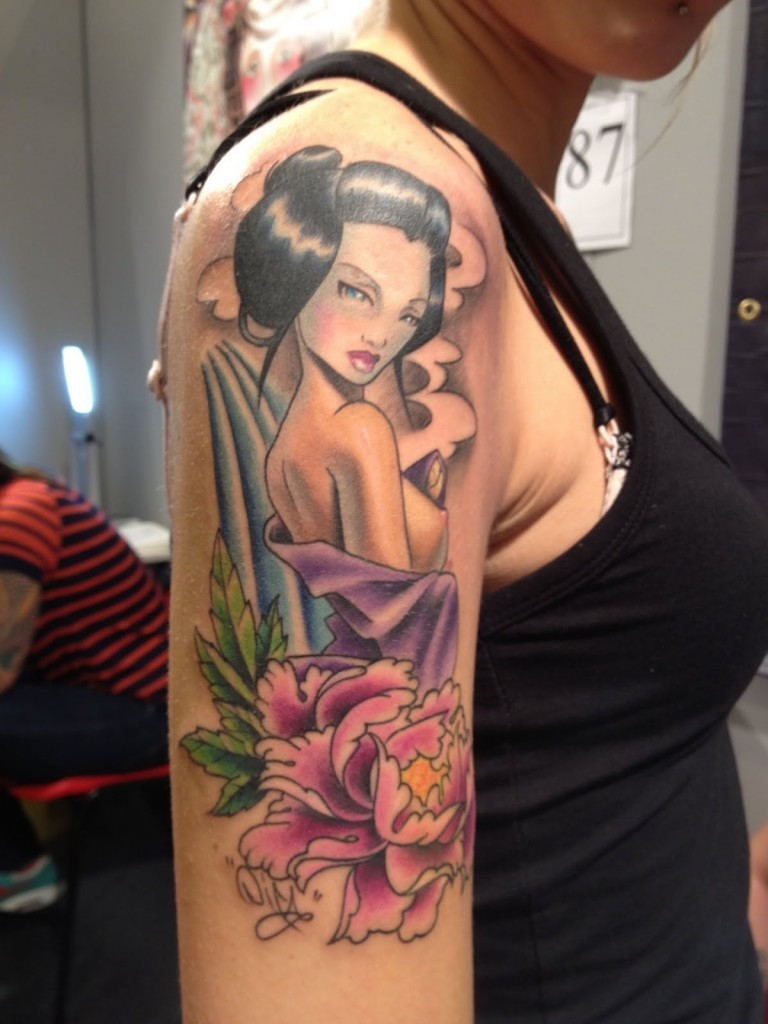 Geisha Pin Up Tattoo On Right Shoulder