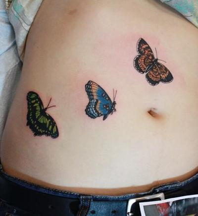 Girl With Butterflies Tattoo On Stomach