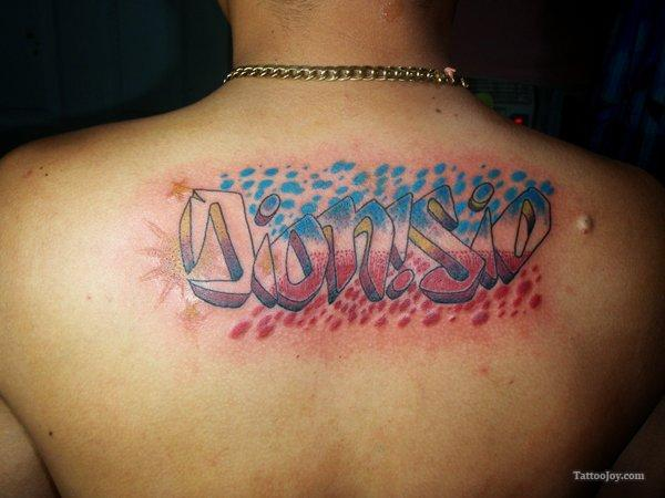 Graffiti Letters Tattoo On Upper Back