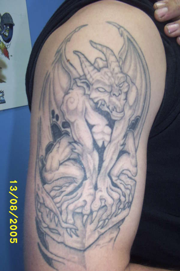 Grey Ink Gargoyle Tattoo Design On Shoulder