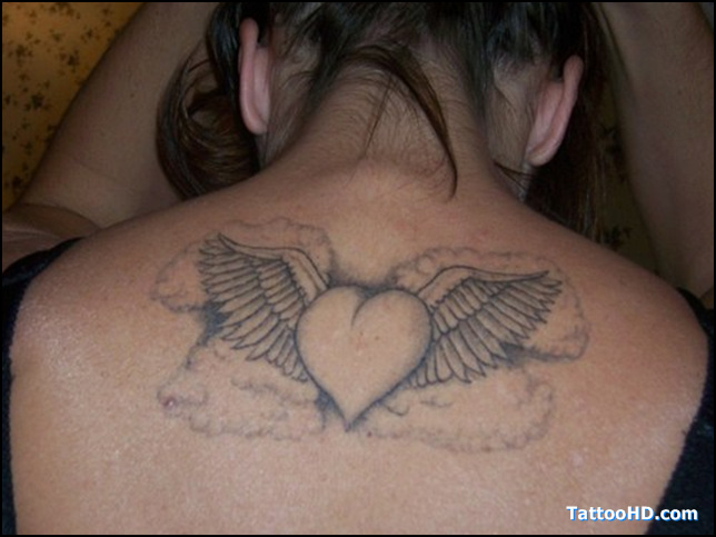 Grey Ink Winged Heart Tattoo On Upper Back
