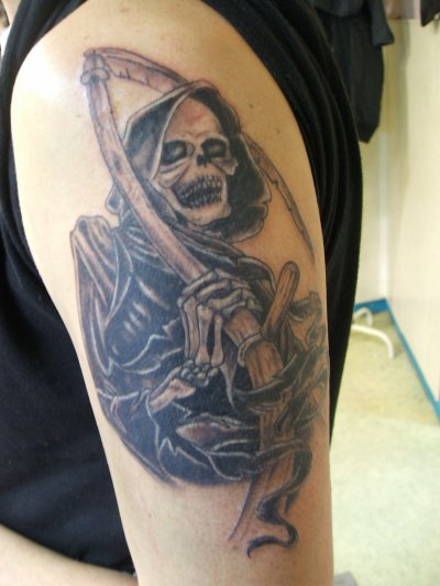 Grim Reaper Tattoo On Biceps
