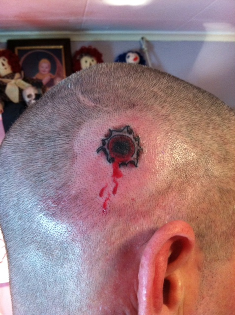 Gun Shot Tattoo On Head
