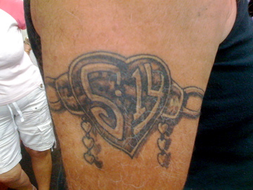 Heart With Chain Tattoo On Biceps