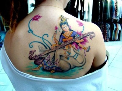 Hindu Goddess Saraswati Tattoo On Back Of Shoulder