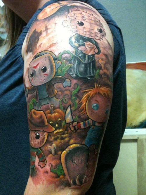 Horror Cartoons Tattoo On Upper Arm