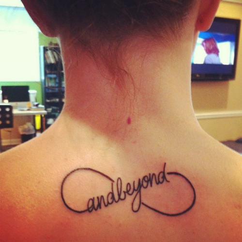 And Beyond Infinity Symbol Tattoo On Back Of Neck