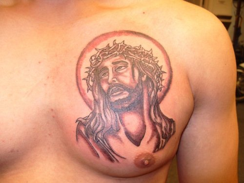 Barbed Jesus Head Tattoo On Chest