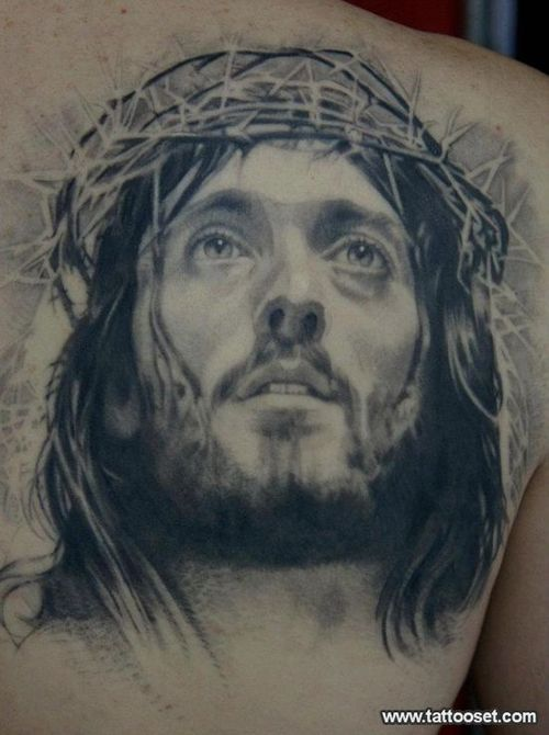 Barbed Jesus Portrait Tattoo On Back Shoulder