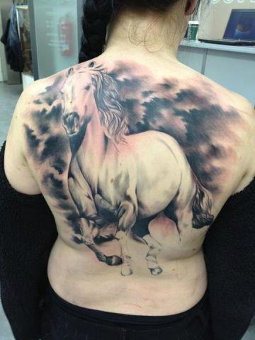 Huge Running Horse Tattoo On Back Of Body
