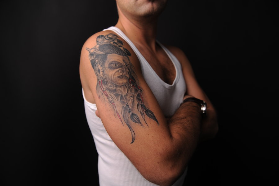 Indian Tattoo On Right Upper Arm For Guys