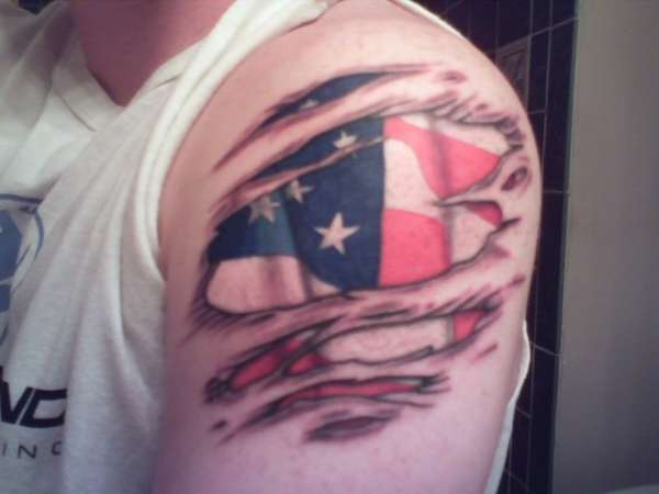 Ripped Skin American Flag Tattoo On Left Shoulder