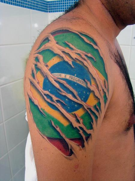 Ripped Skin Brazil Flag Tattoo On Shoulder