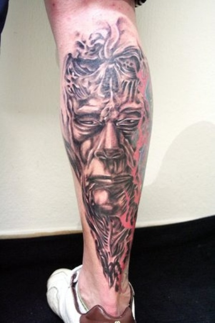 3D Biomechanical Face Tattoo On Leg