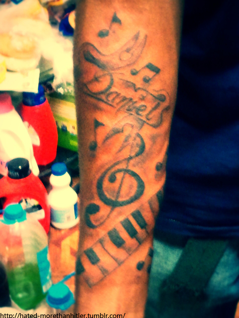 violin-key-and-piano-keys-tattoo-on-right-arm