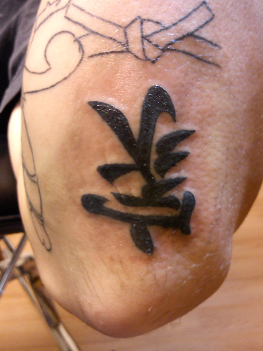 A Black Ink Kanji Tattoo Design