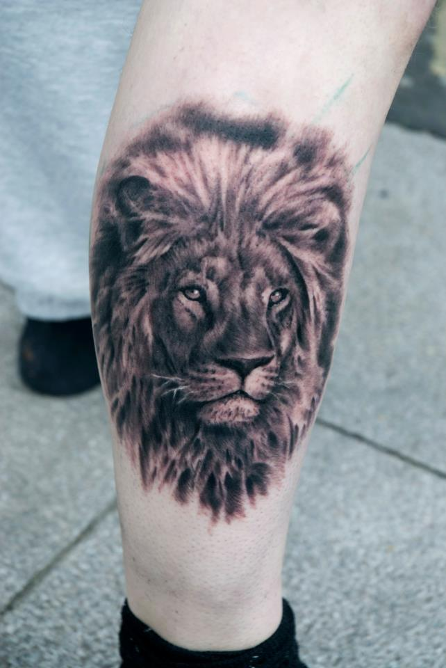 A Lion Comes Alive In This Photo Realistic Black And White Portrait Tattoo Design