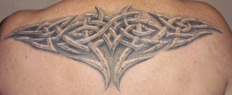 Amazing Celtic Knot Tattoo On Upper Back