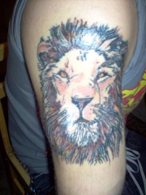 Amazing Lion Face Tattoo For Men On Biceps