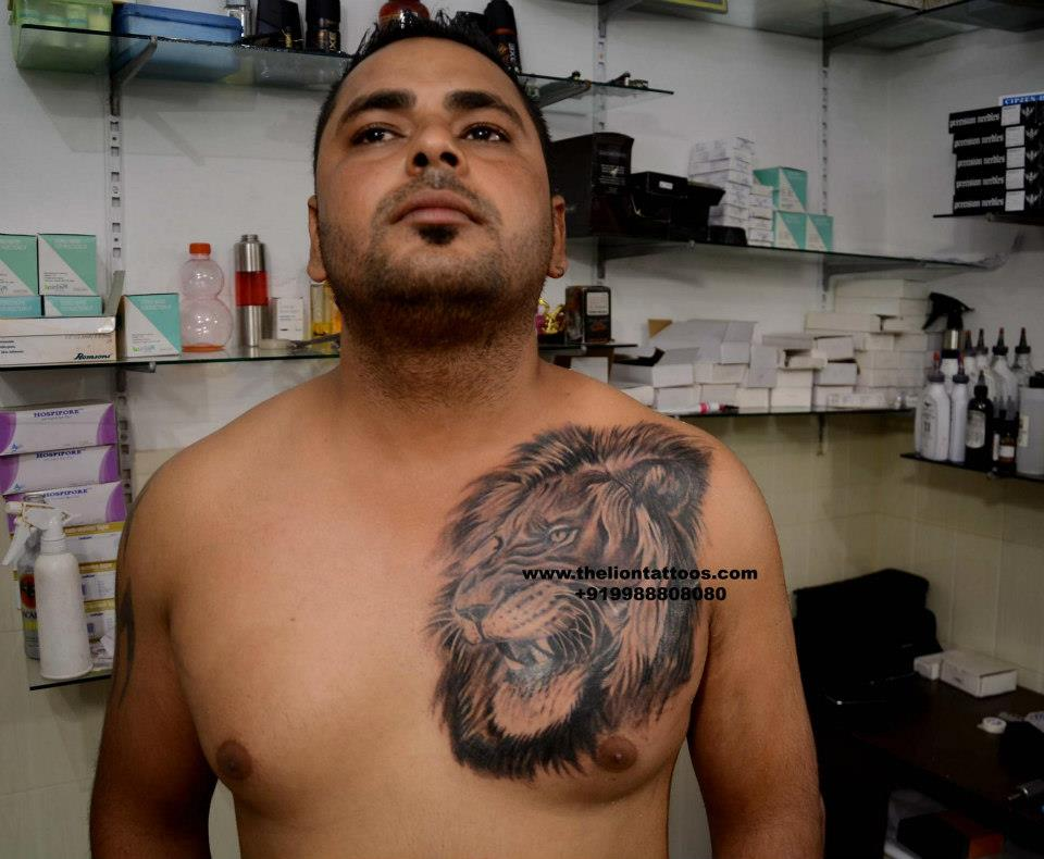 Angry Lion Face Tattoo On Chest