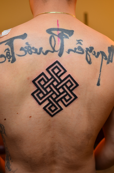 Awesome Endless Knot Tattoo For Back