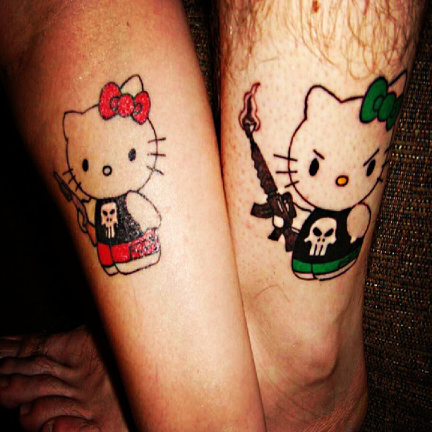 Awesome Hello Kitty Couple Tattoo On Leg