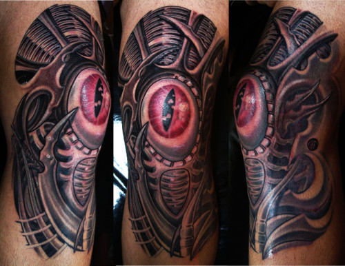 Biomechanical Eye Knee Tattoo Design