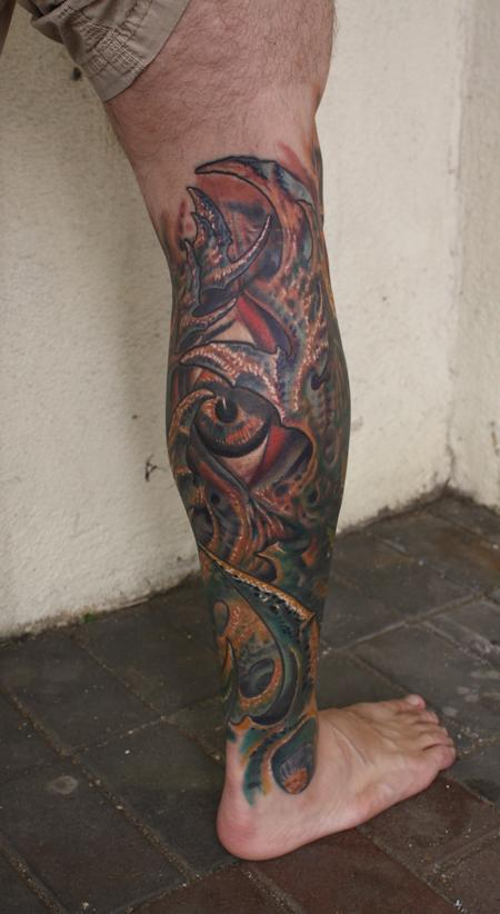 Biomechanical Eye Leg Tattoo Design