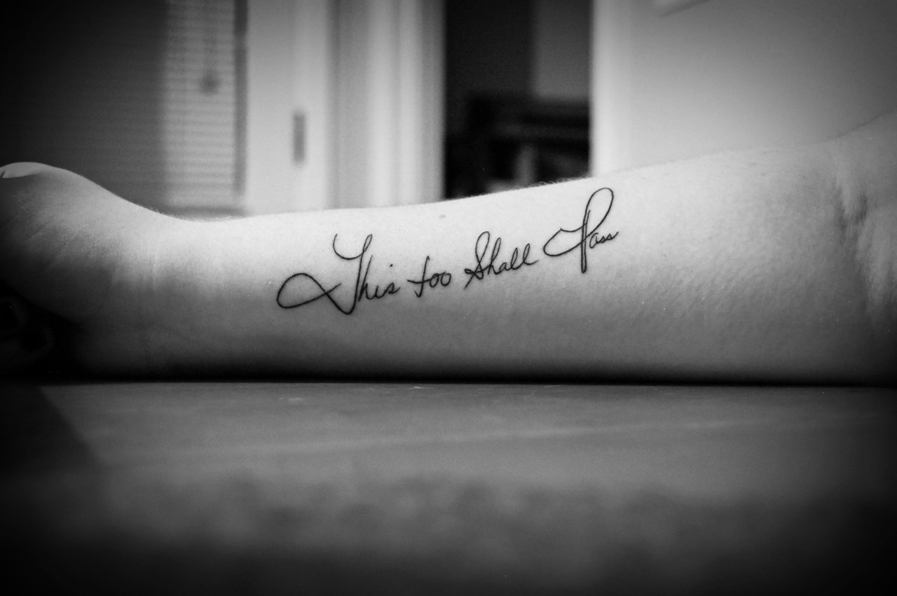 Black And White Lettering Tattoo On Arm