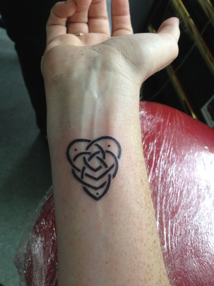 Black Motherhood Knot Tattoo On Wrist