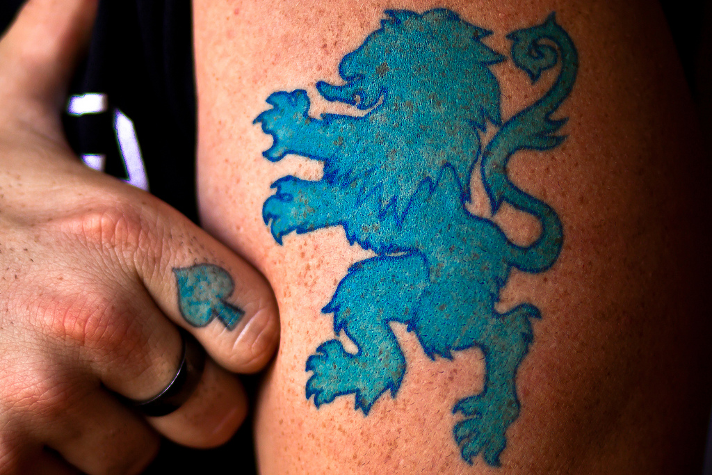 Blue Ink Finnish Lion Tattoo Design