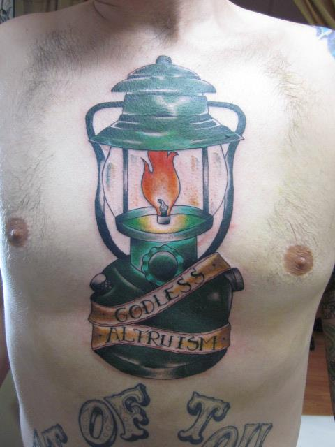 Burning Candle Lamp Tattoo On Chest For Men