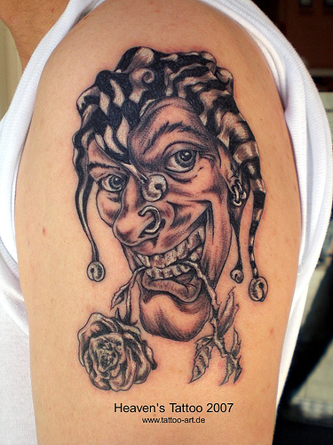Crazy Joker Clown With Rose Tattoo On Shoulder