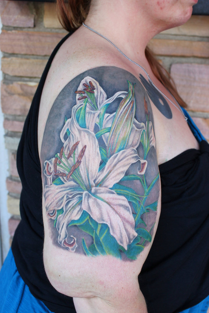Easter Lilies Sitting Tattoo On Upper Arm For Women