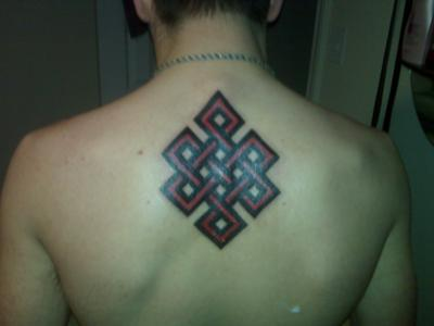 Endless Knot Tattoo On Upper Back